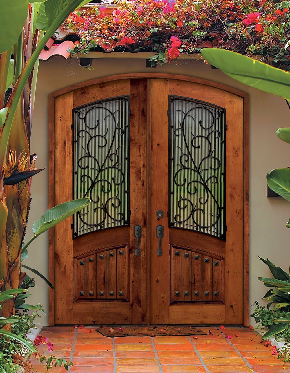 Beautiful Arch Top Double Entry Doors With Bellagio Wrought Iron Design The Unique Pattern On This Knotty Alder Wood Door Adds Rustic Elegance To Home