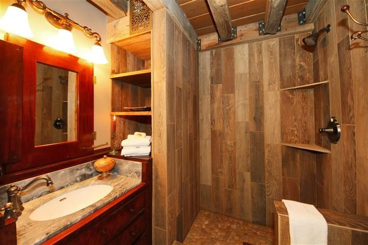Rustic Bathroom With Wood Tiled Shower And Antique Dry
