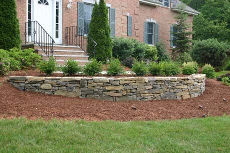 8 Freestanding And Retaining Stone Wall Designs That Will Add Dimension To Your Property Landscaping Retaining Walls Rock Wall Landscape Landscaping Blocks