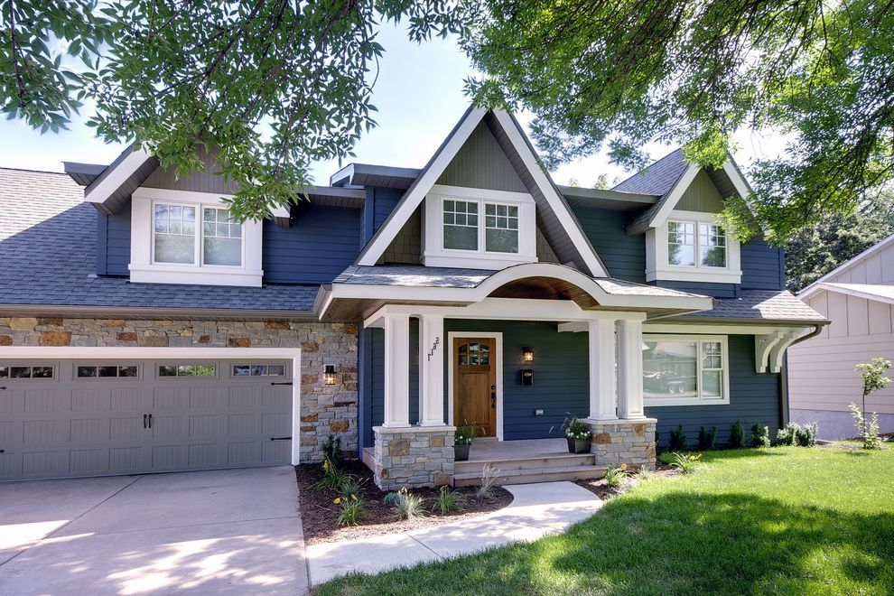 Slate Blue Vinyl Siding With Traditional Exterior Also Blue House Carriage Doors Dorme Exterior Paint Colors For House House Exterior Blue House Paint Exterior