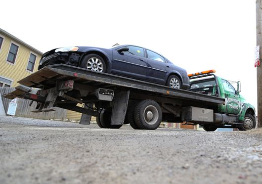 A Shamrock Towing, Inc. tow truck pulls into a vehicle storage location on Feb. 4 at 1145 Hamlet St. in Columbus. Credit: Mark Batke / Photo editor