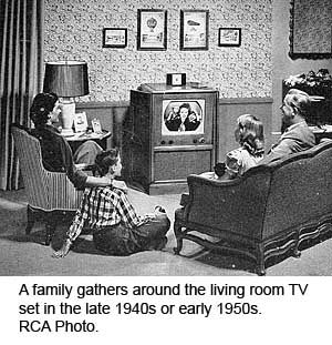 A Family Gathers Around The Living Room TV Set In The Late S - Living room war