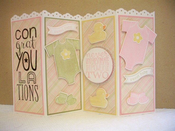 """Something for Baby by D.Wicks, Reg.sized card, 8.5""""x5.5"""" shortened by punching. Fold card in half & then fold ea panel back in half (2 1/8""""from ea end). Mailing:fold card in half,as usual! Stamps:Bravo,Something for Baby,Yippee-Skippee! CS:W White,Pear Pizzaz,So Saffron, Glimmer CS Silver,Pretty in Pink(R), dsp Pawsitively Prints Ink:Black Memnto,Pretty in Pink(R.),PearPizzaz, Markers: So Saffron,Pumpkin Pie Acc:Border Pnch(R),Fmlits Bitty Banners, Baby's First, Pnches:1 3/8""""& 2"""" circles…"""