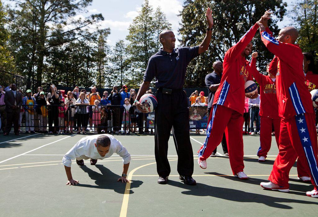 President Obama does push-ups on the White House Basketball