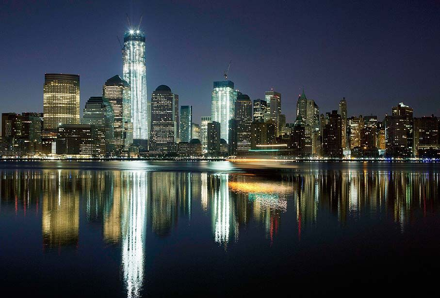 New York — The new World Trade Center building towers above the Lower Manhattan skyline and Hudson River on March 26.