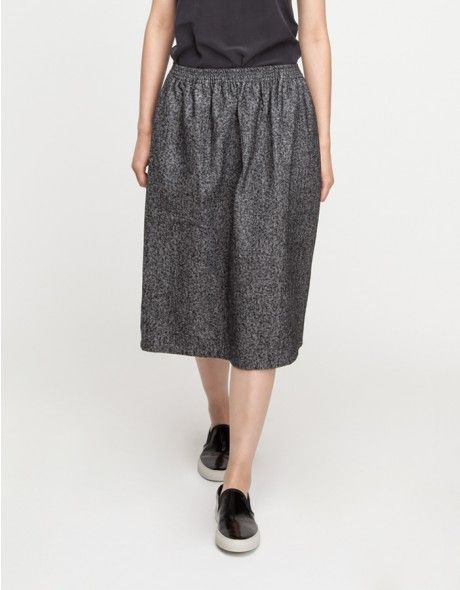 From Base Range, a soft, gray wool blend skirt. Features an elasticized waistline, front pockets and relaxed fit throughout the body.  	•	Gray wool blend skirt 	•	Elasticized waistline 	•	Relaxed fit 	•	Front pockets 	•	50% wool, 50% cotton 	•	Dry