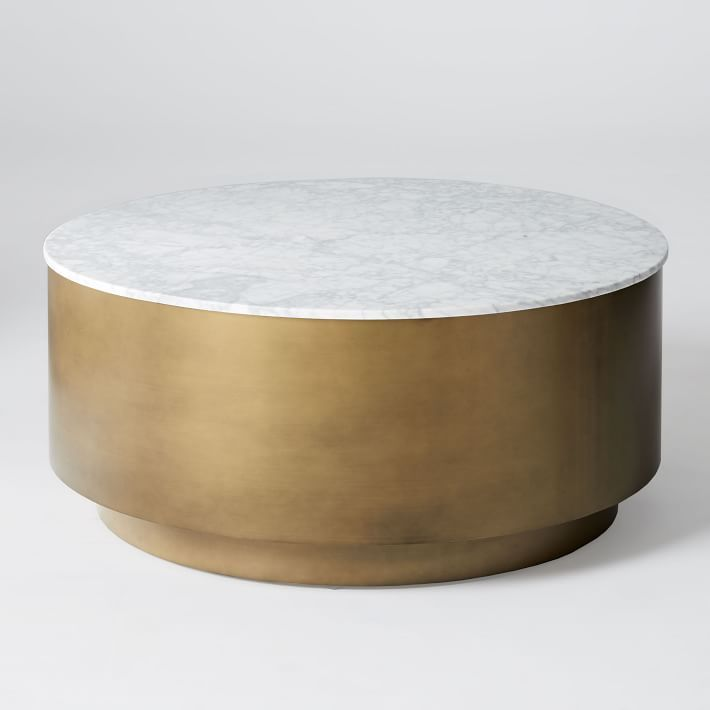 Our Marble Metal Drum Coffee Table S Base Is Buffed To A Smooth Finish And Topped With Perfectly Round Slab Of White It The Ideal Surface For