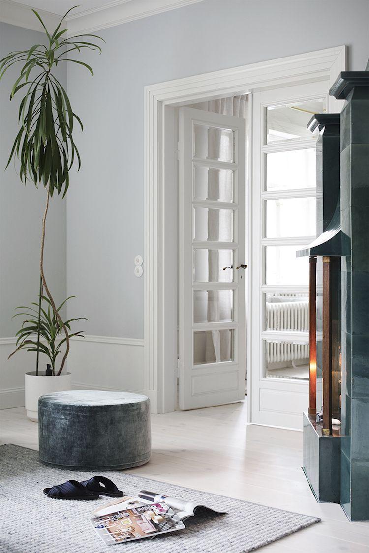 Beautiful white and light grey-blue sitting room in the Finnish home of Maija Rasila.