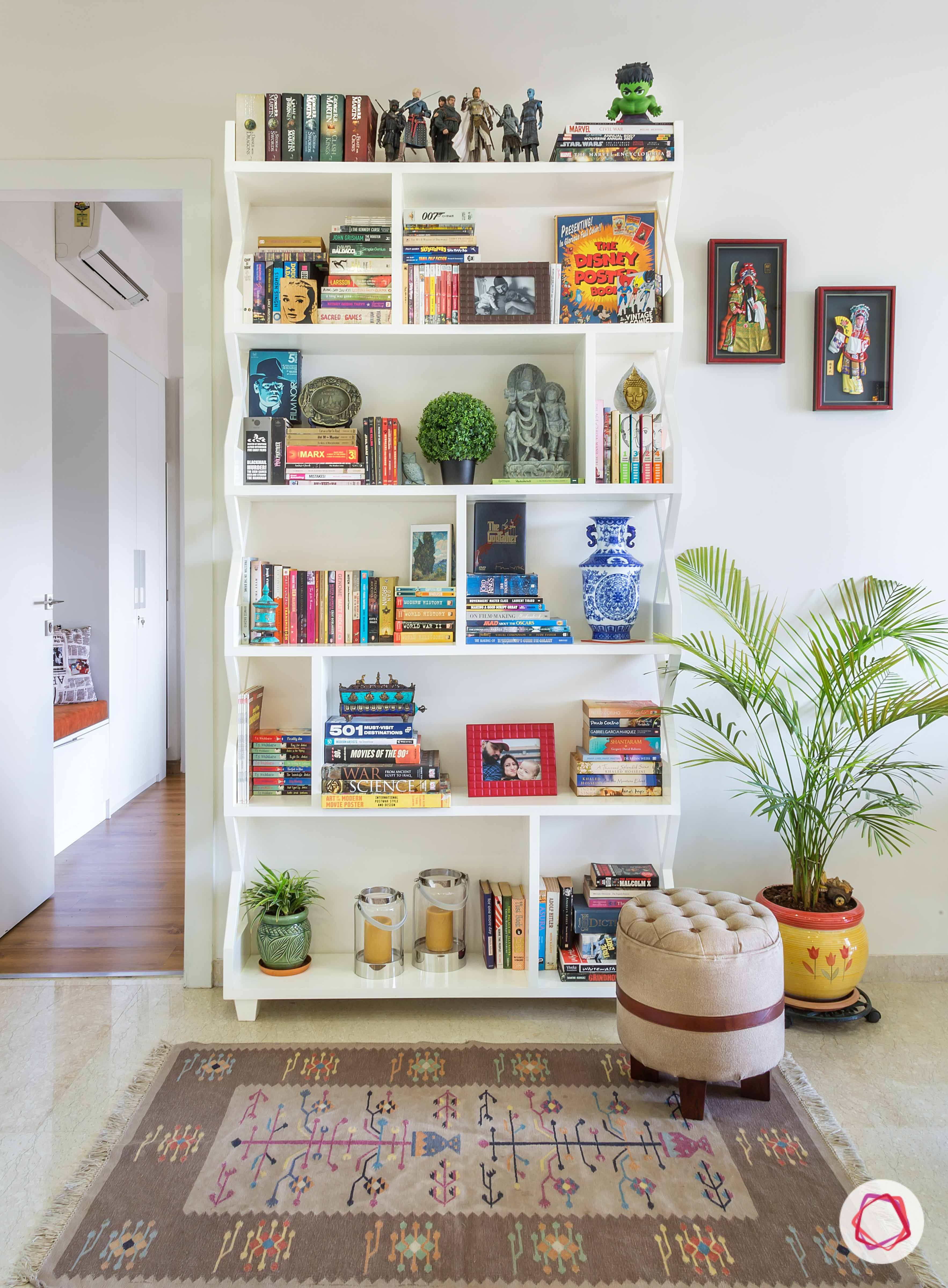 How to organize your bookcase take  cue from this livspacehome white mumbai books toys popculture also rh pinterest