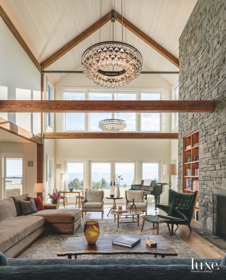 High Ceiling Stone Fireplace Great Room With Chandelier