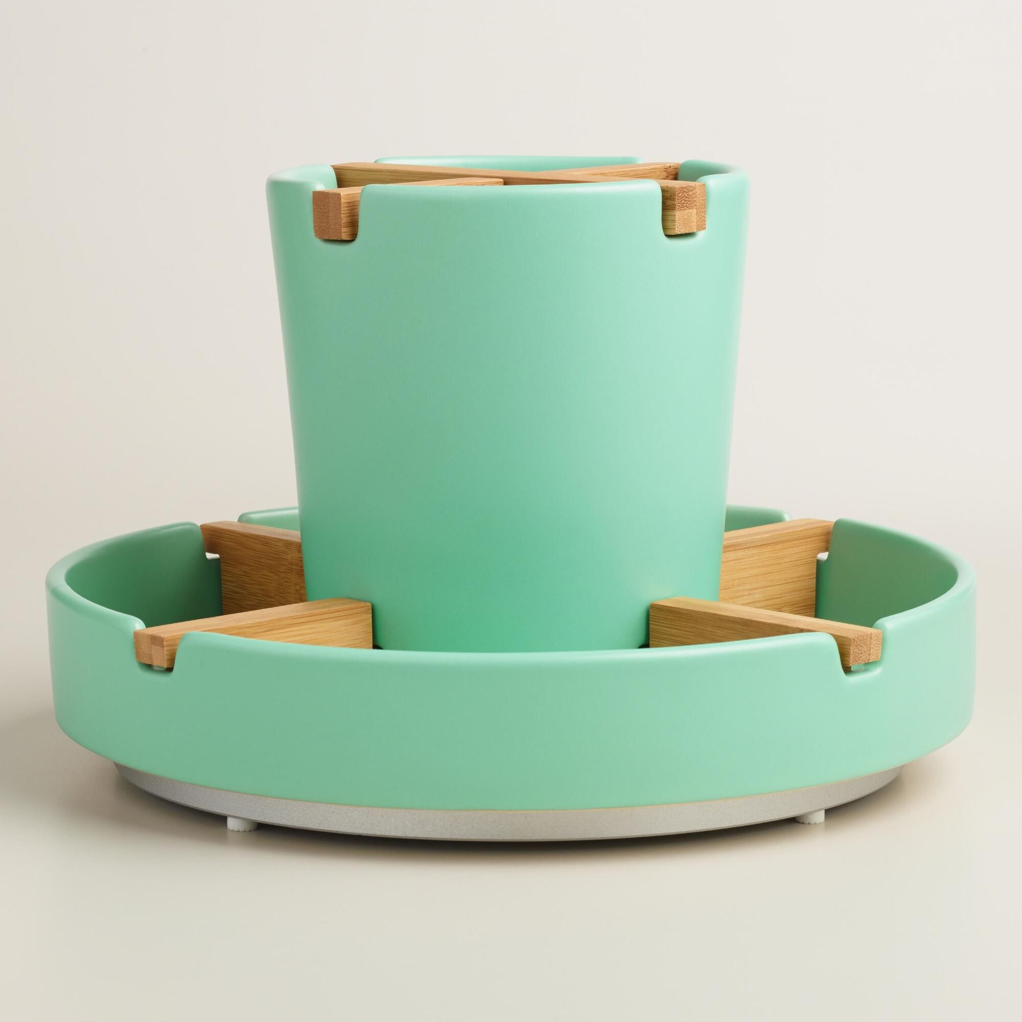 Made of stoneware with a bright aqua finish, our exclusive rotating ...