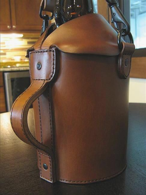 GC-1L leather beer growler case in medium brown with black stitching.