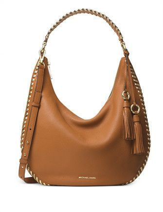 7cbae0e508 Whipstitch trim lends artisanal appeal to the Lauryn shoulder bag. This  slouchy leather design is a study in subtle sophistication.