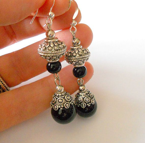 Hey, I found this really awesome Etsy listing at https://www.etsy.com/listing/120368895/black-dangle-earrings-onyx-and-silver