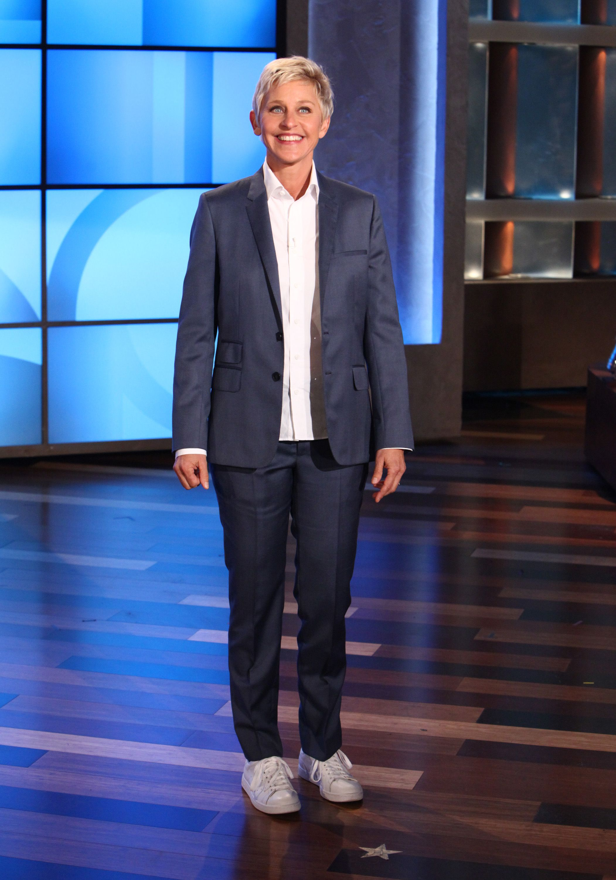 Ellen's Look of the Day: Blue suit, crisp white shirt, Stan Smith Adidas shoes, Falke socks.