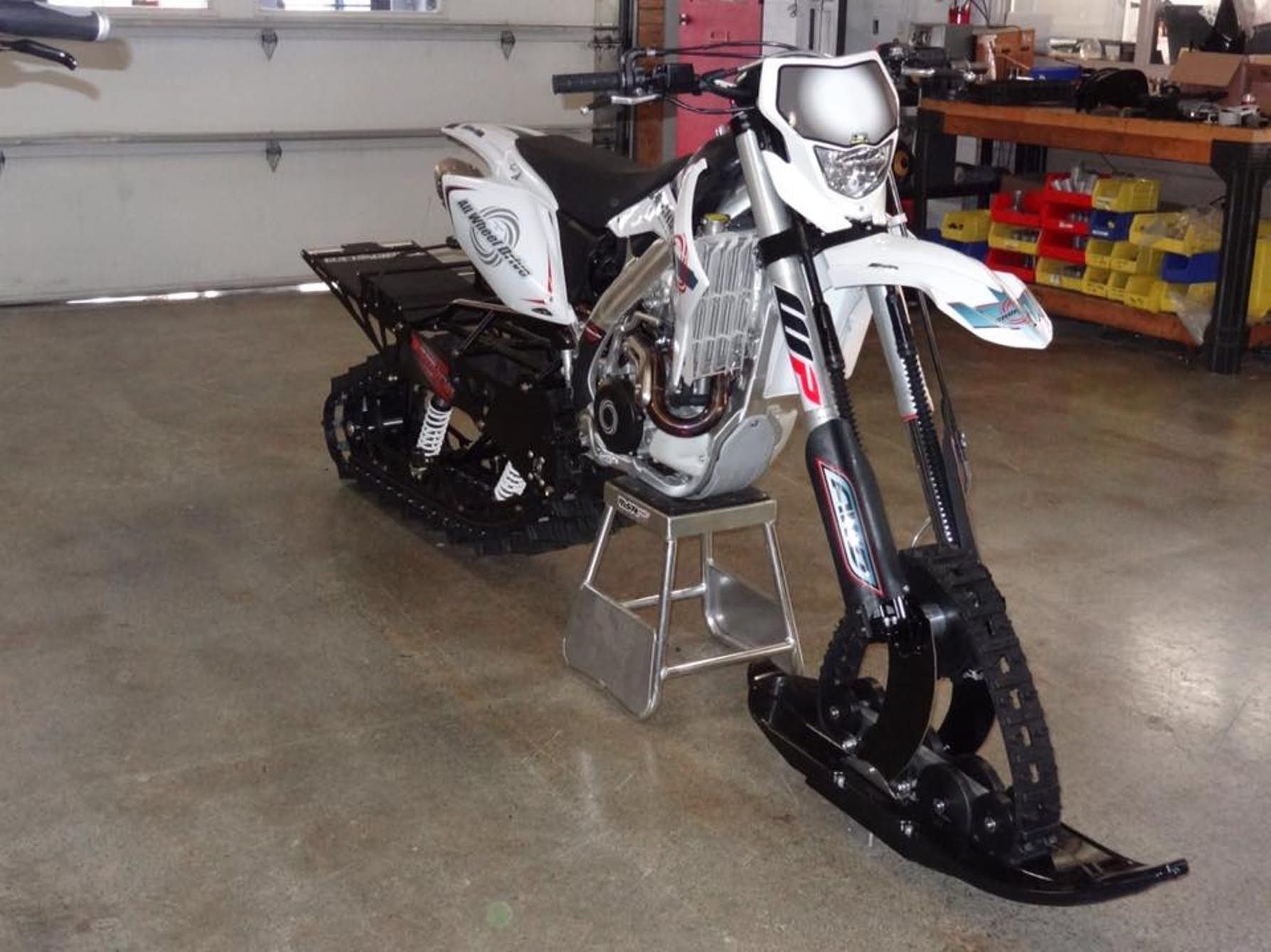 Christini S Ii Track Snow Bike System Must Be Added To One Of The Company S Existing All Wheel Drive Motorbikes Bike Motorcycle Dirt Bike Snowbike