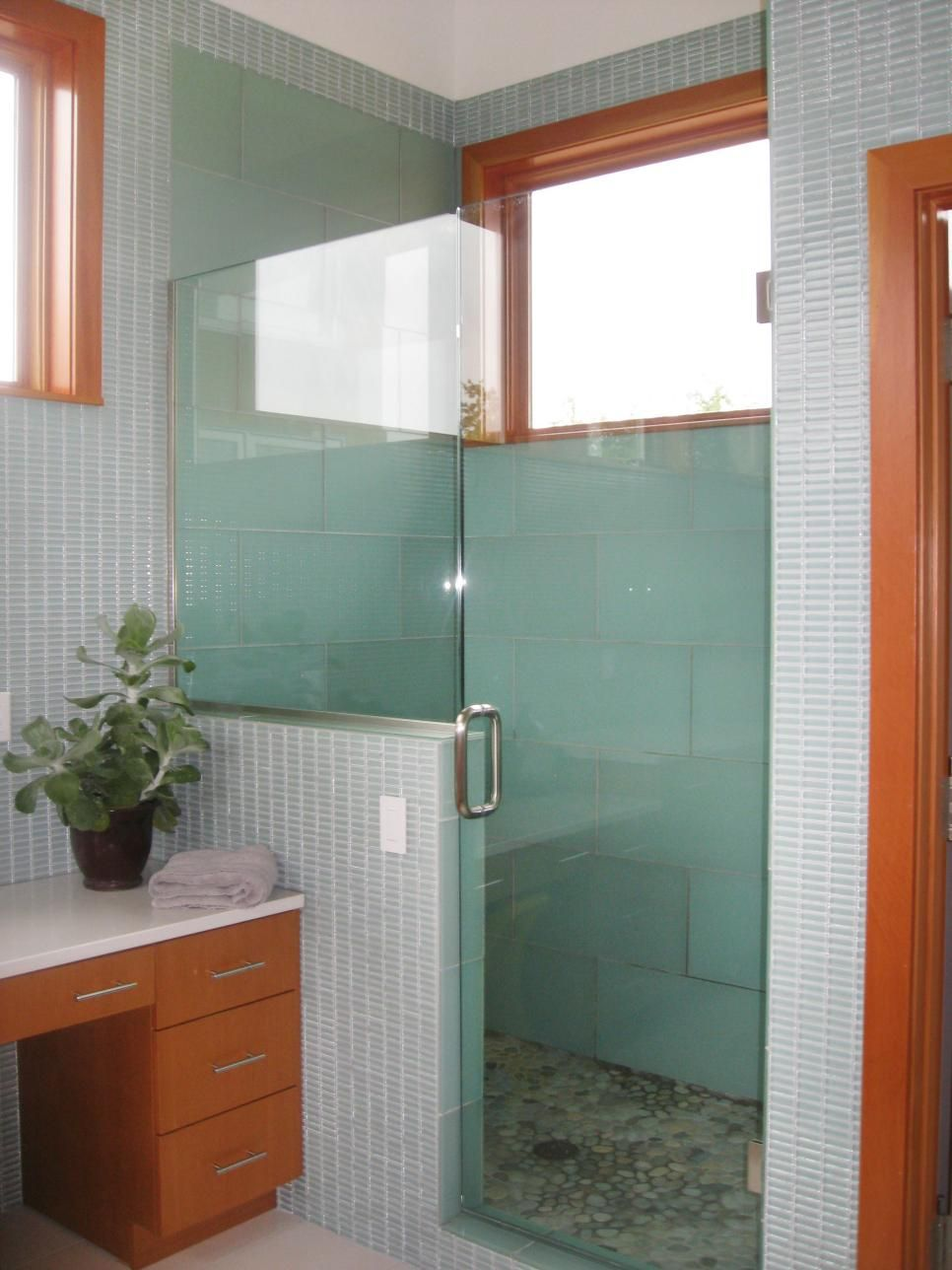 Using large tiles on the shower walls lessens the amount of grout ...