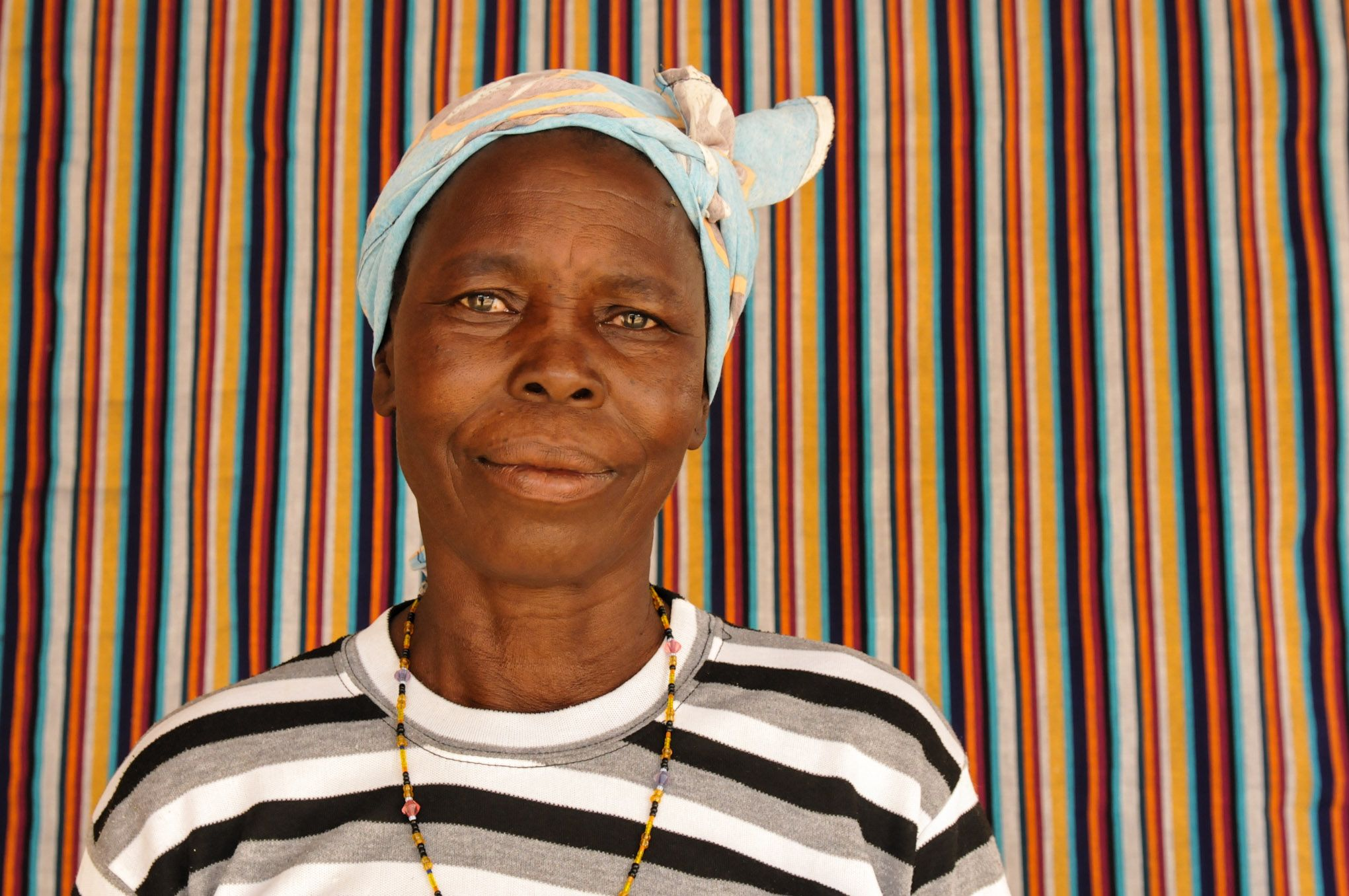 """""""I began working for the cooperative in 2007 as a dyer, and now I am a weaver. This job allows me to pay school fees for my seven children."""" says Rosalie, an artisan from Burkina Faso  © ITC Ethical Fashion Initiative & Anne Mimault"""