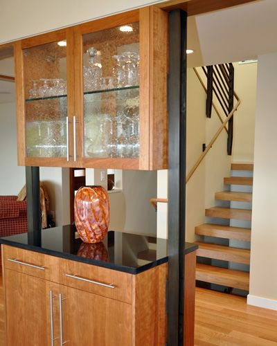 With the old fireplace gone a decision to define the rooms with an ...