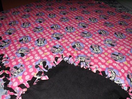 large  handmade fleece minnie mouse  blanket with a black backing ..so nice