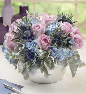Silver Vase Of Blue And Purple Flowers Centerpiece Flower Arrangements Flower Arrangements Center Pieces Floral Arrangements