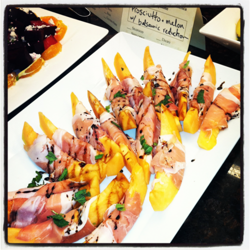 Prosciutto wrapped cantaloupe with a balsamic reduction