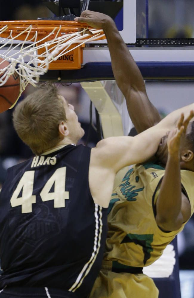Notre Dame guard Demetrius Jackson (11), right, is hit by