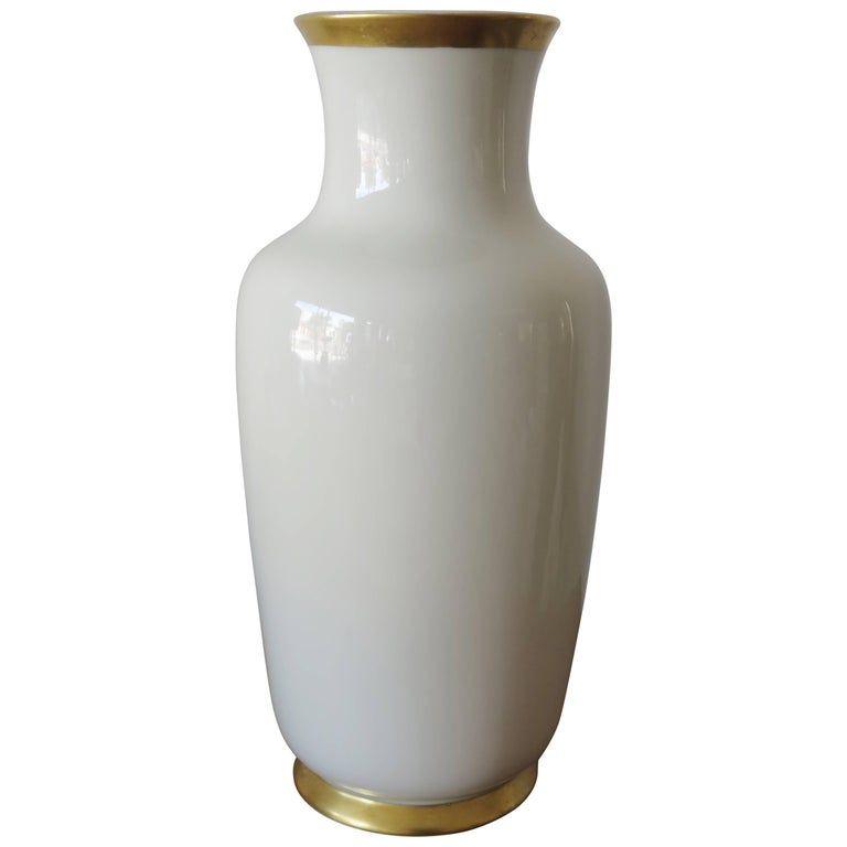An elegant vase by German maker Gerold Porzellan, circa 1950. White glaze with gold accent.