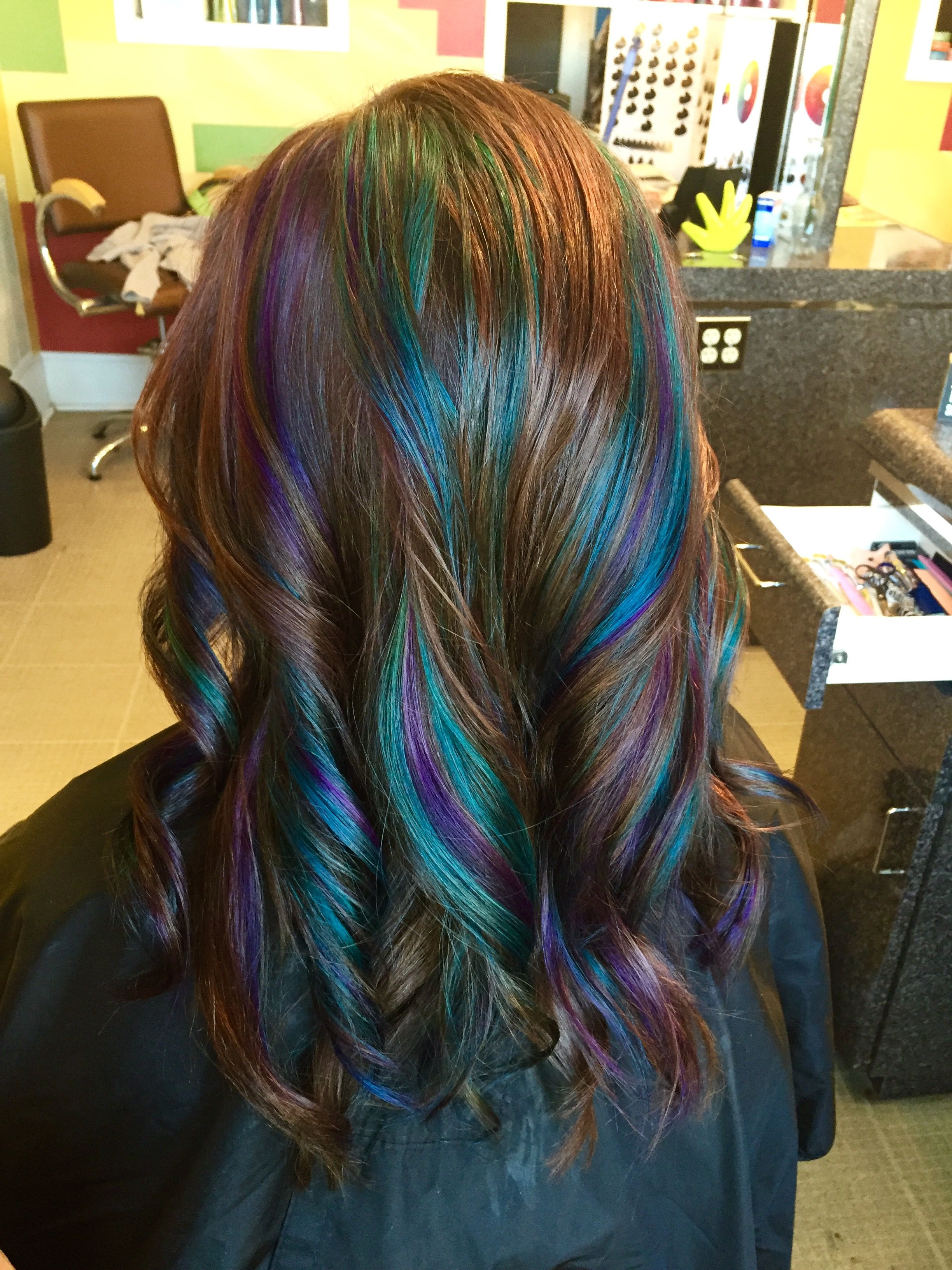 Brown haircolor with peacock teal and purple highlights