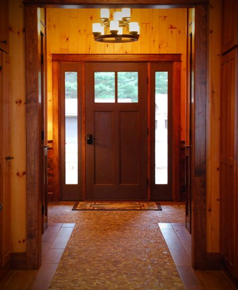 Stone And Wood Make A Dark Masculine Interior: Interior Photo Looking Toward Front Entry, Light Wood
