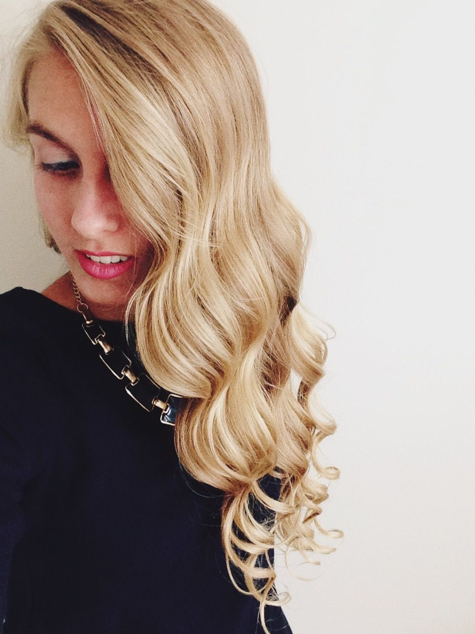 """Use a 1"""" curling wand to wrap hair around in small sections. When finished, flip head upside down to shake out and voila! Wrap the hair all in the same direction for an old Hollywood look or in different directions for a more natural look."""