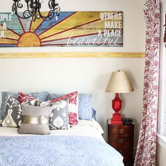 This gorgeous bedroom is not afraid to mix patterns and bright colors. (via Inspired by Charm)