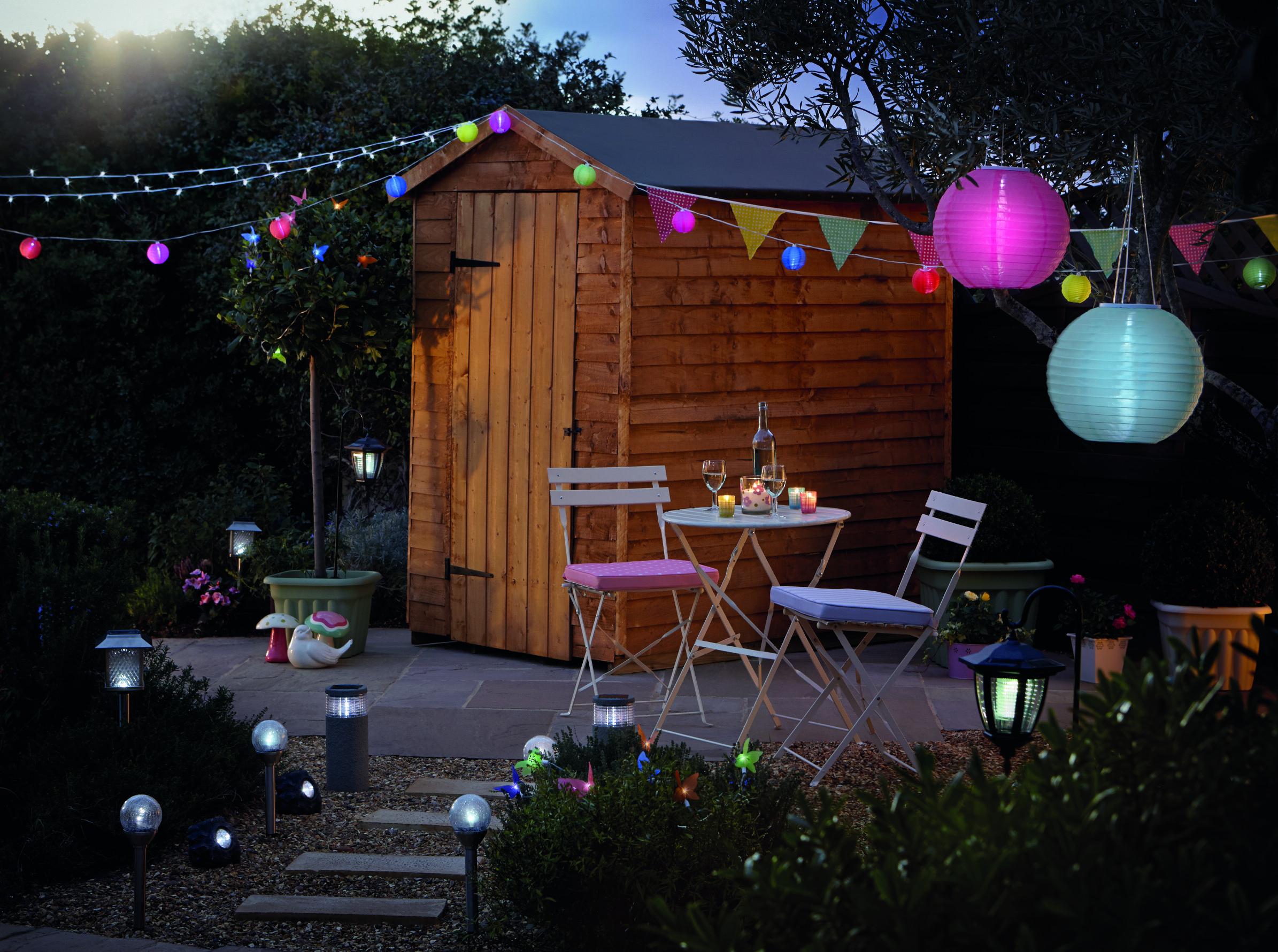 brighten up your garden on warm summer nights with solar. Black Bedroom Furniture Sets. Home Design Ideas