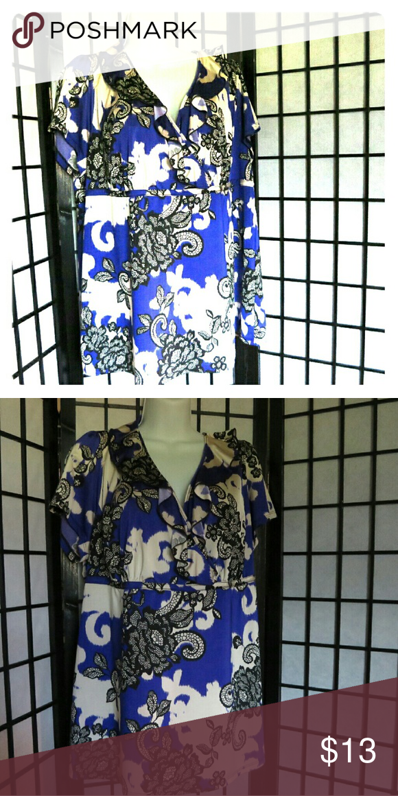 Layne Bryant Tunic 18/20 Floral flowing ruffled tunic. Great to wear with jeggings, Legging etc, Comfortable . Elastic  under bodice. You can see the band in the photo. It is not tight . Designed to give top a fitted look. Blue,  Black and White. 18/20 Layne Bryant  Tops Tunics