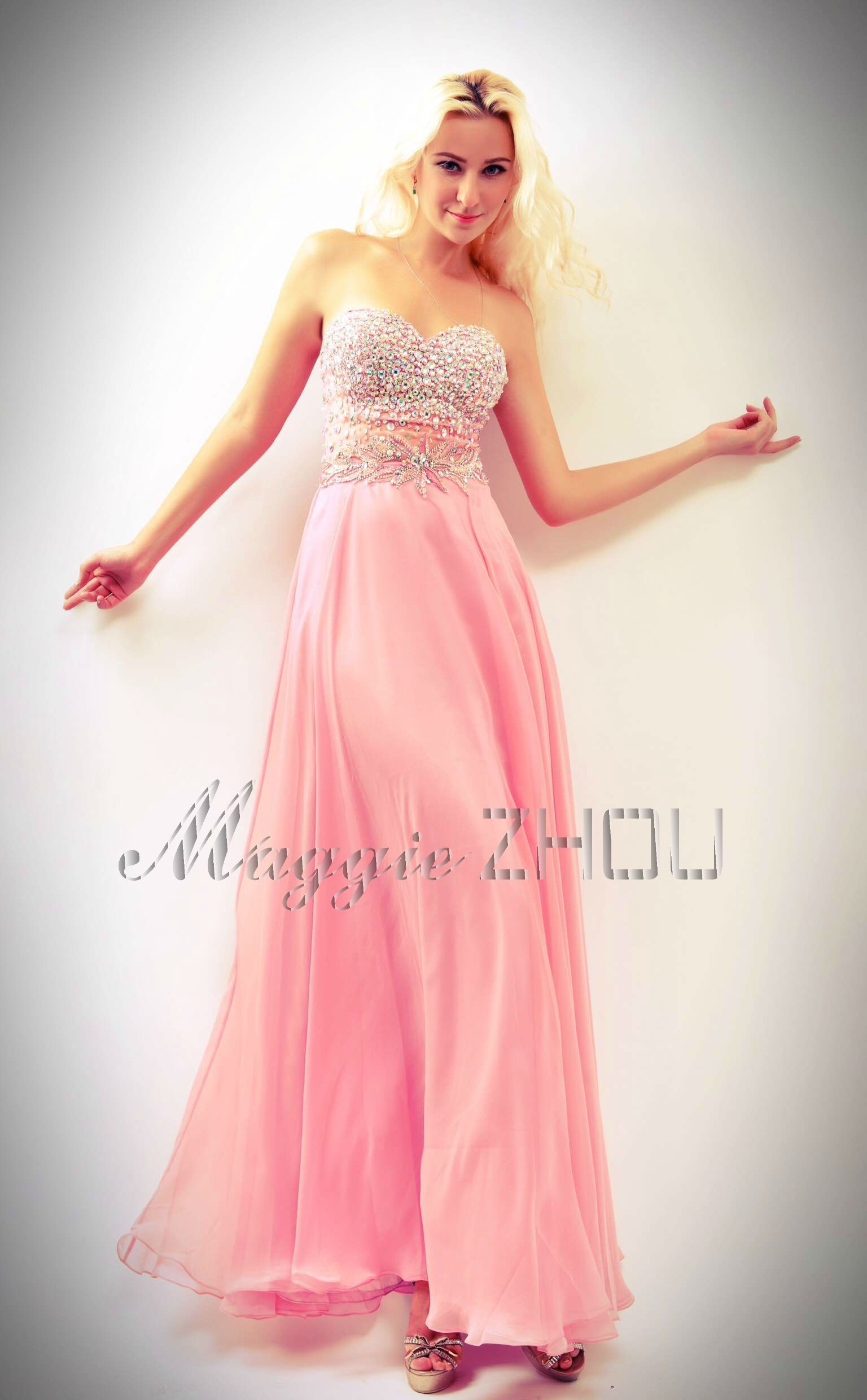 Stunning Maggie Zhou Prom Dress With Flowing Pink Skirt And Hand Beaded Sweetheart Neckline Higher Waistline Creates A Trim Silhouette Designed To Make You