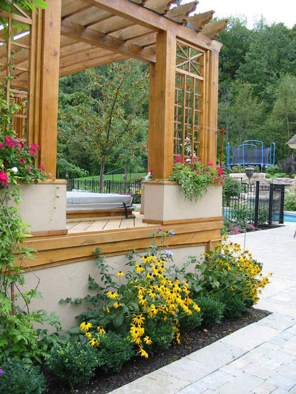 By incorporating planter boxes into this pergola it helps for Yard planter ideas