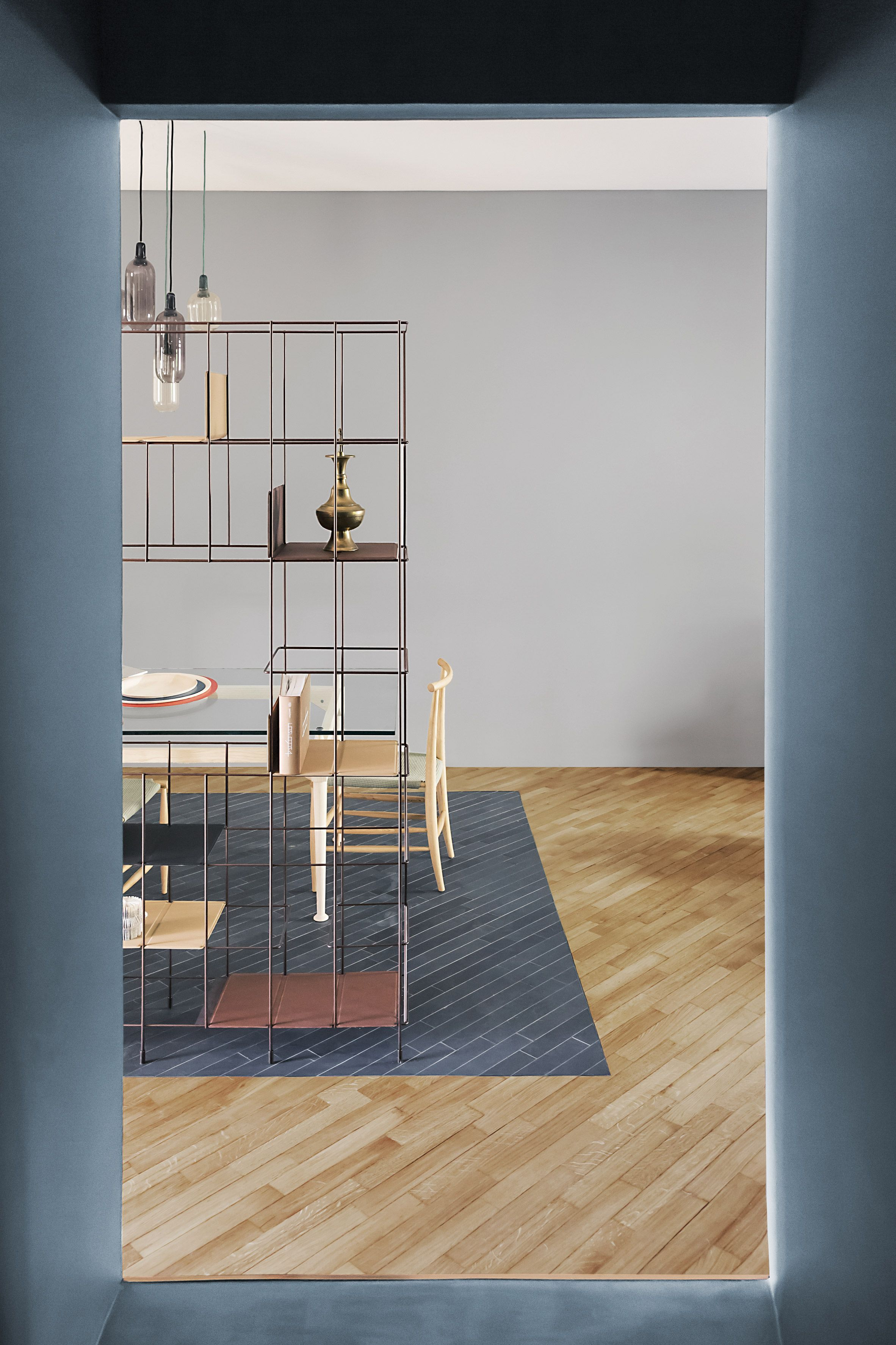 Italian design studio AIM has renovated the interior of a home in