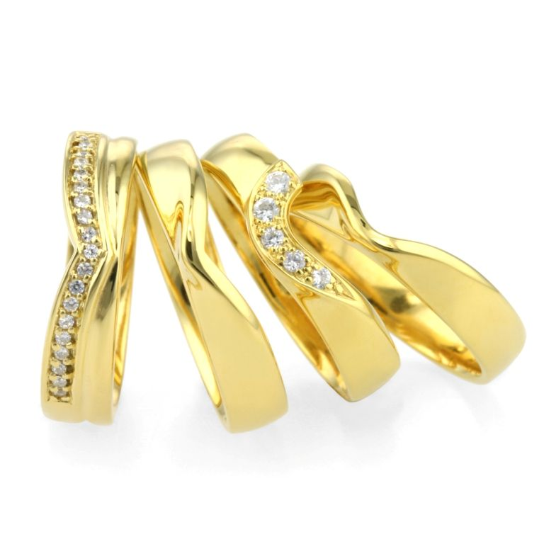 four yellow gold bands shaped to complement your