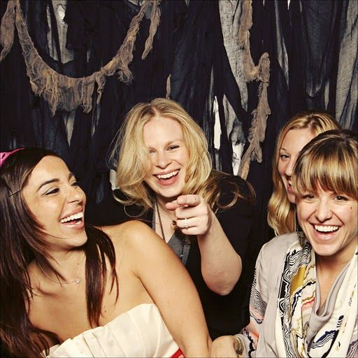 Women laughing with black background | Women laughing, Girls night out,  Business women