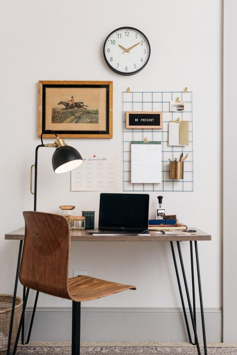 Home Office With Playful Arrangement Of Wall Art And Organizer