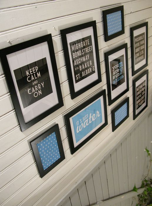 Framed wall with quotes, paper patterns, black and white photos