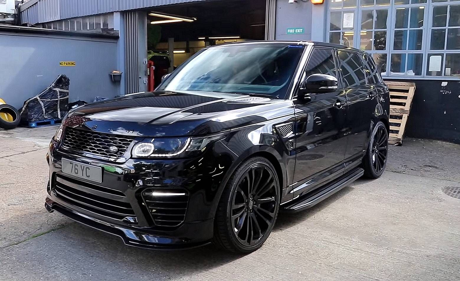 hight resolution of black range rover svr with carbon details savage