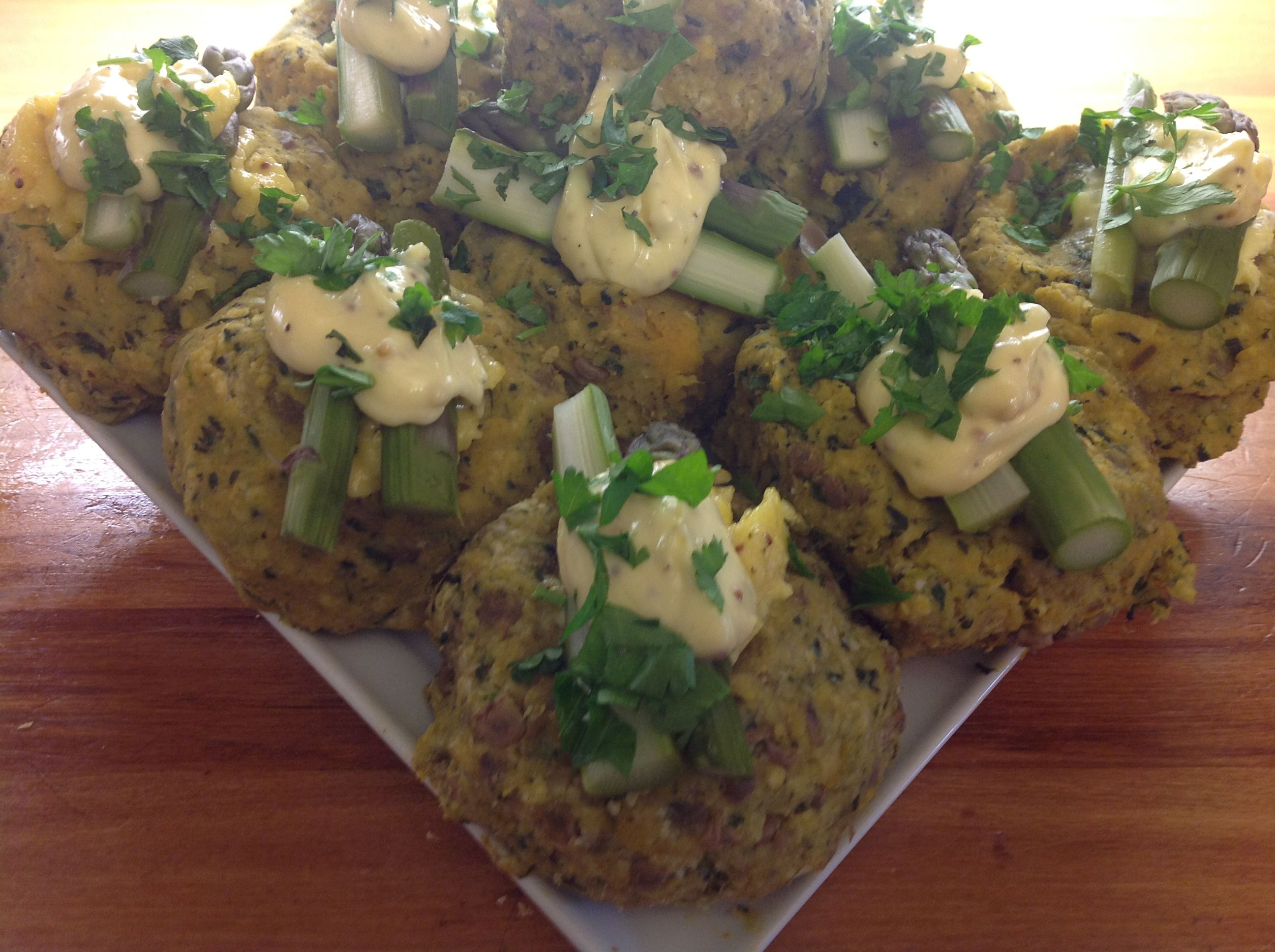Kumera and pumpkin cakes with fresh asparagus, italian parsley and lemon aoili