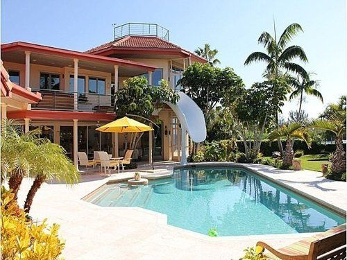 check out how this house incorporated a water slide to go with their pool