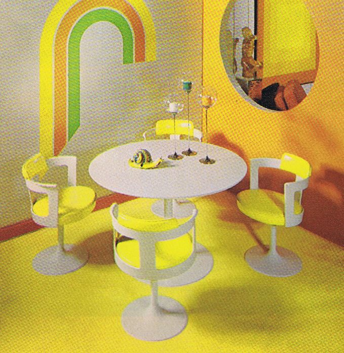 I found this totally cool picture of a yellow and white dinette set in a 1971 Good Housekeeping Magazine. Love the three color rainbow, don't you? The whole look is very mod, but the chairs look way too delicate to handle today's average American. I don't really see Larry the Cable Guy making it through a dinner here.