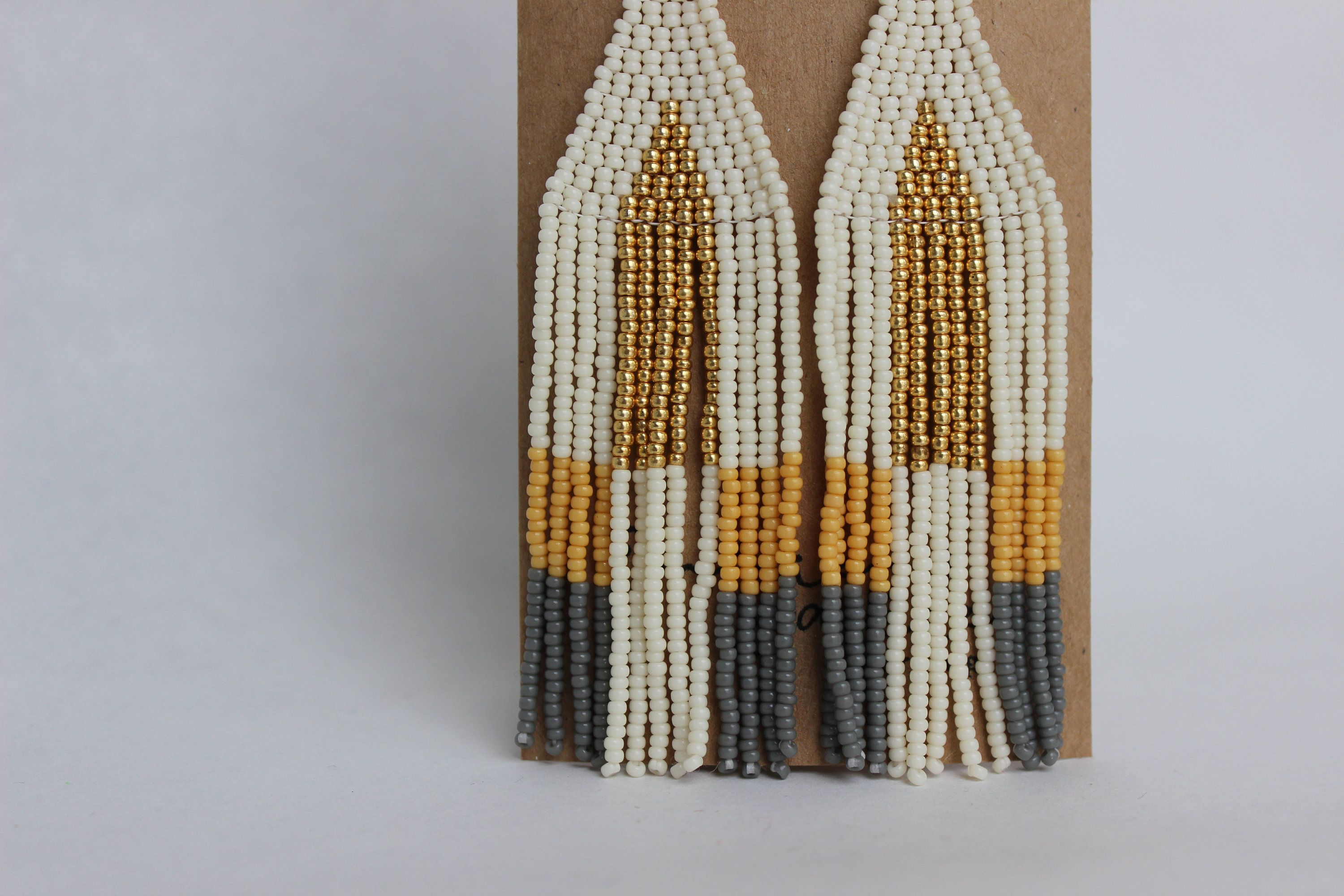 Excited to share this item from my #etsy shop: Long Dangly Earrings, Handwoven Seed Bead Earrings, Simple Colors, Gold Accented Earrings