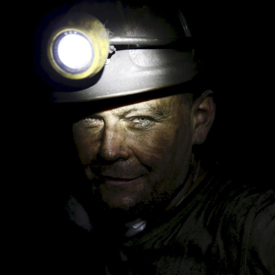 Miner - 01 October 2015 - Piotr Dytko 42 a miner who has has worked for 24 years in mines looks on as he works about 500 meters underground at the Boleslaw Smialy coal mine a unit of coal miner Kompania Weglowa (KW) in Laziska Gorne Silesia southern Poland September 11 2015. Coal mining has taken centre stage in the campaign for this month's parliamentary election in Poland an outsize political role that threatens the country's hard-won economic growth and reputation in Europe. Picture taken…