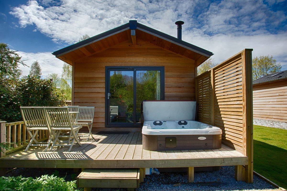 Braidhaugh Riverside Lodge With Spa Pool Classic Scottish Glamping Lodges With Hot Tubs Luxury Pools Indoor Hot Tubs Saunas