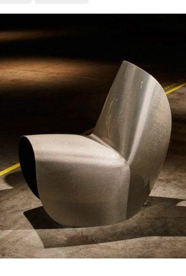 Carbon fibre version of Zaha Hadid\u0027s Kuki chair launches Assises