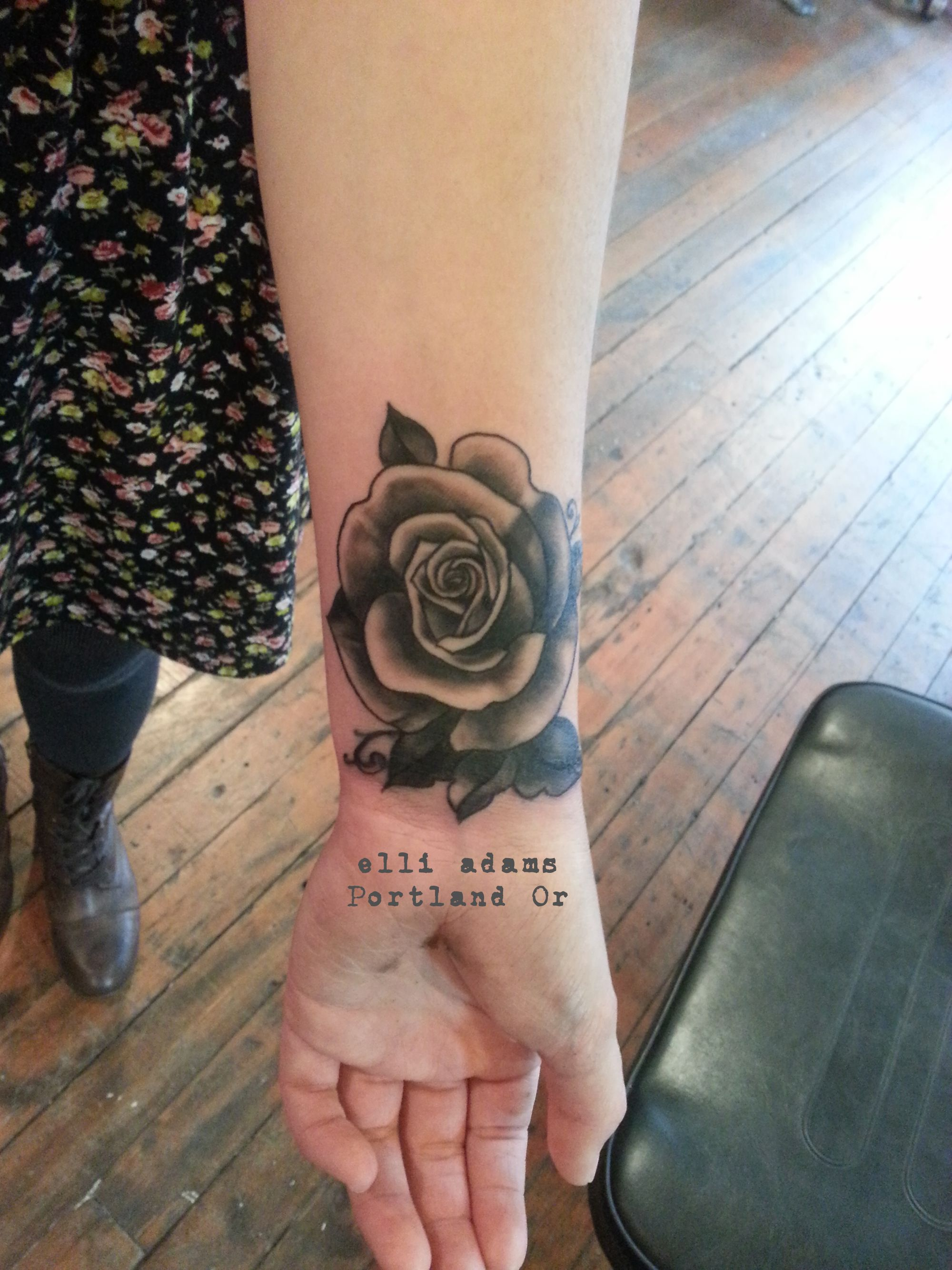 A little coverup, black and grey rose on a wrist